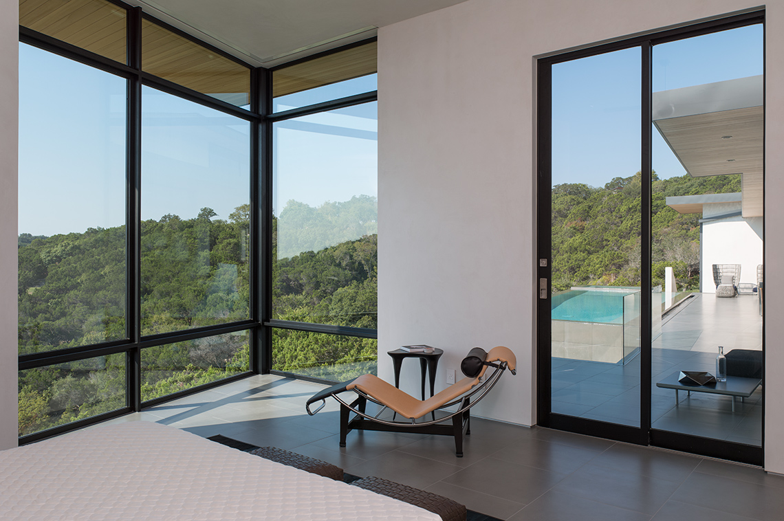 Master Bedroom with lounge chair and pool view