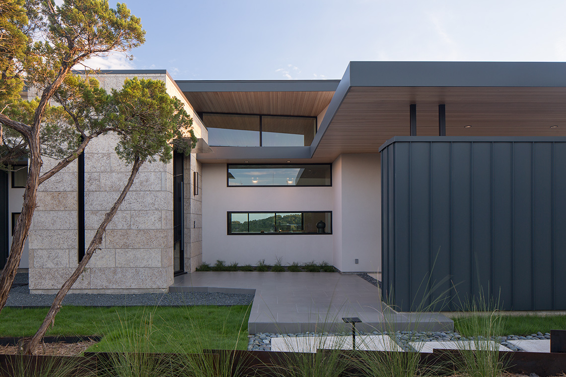 Stucco and metal siding, terraced front yard modern